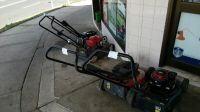 Mower Shop With Victa 2 Strokes Outside.