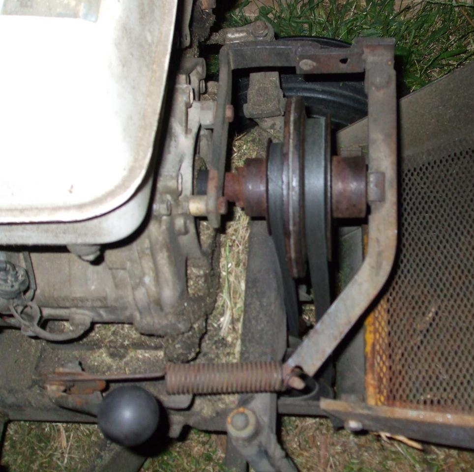 There are two pulleys on the front of the crankshaft. The front pulley,  right at the front of the mower, is driven through a clutch operated by a  spring and ...